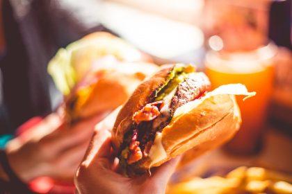 enjoying-a-tasty-burger-picjumbo-com